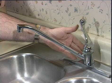 fixing a leaky kitchen faucet repairing a faucet