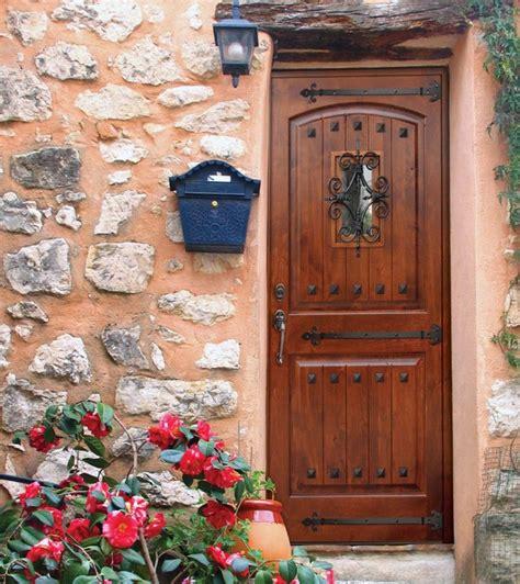mediterranean front door 2 panel v grooved clavos knotty alder single door 80