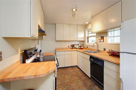 what is the best way to paint kitchen cabinets white kitchen painting laminate kitchen cabinets what is the