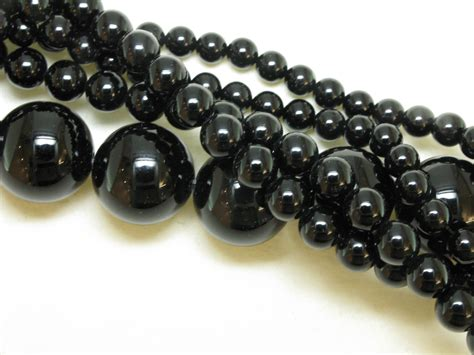 black bead discover the power of black with gemstone jewellery