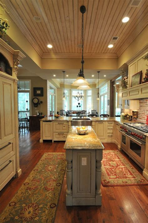 kitchen with center island southern coastal homes with a bigger center island though ceiling dining dishwasher drawers