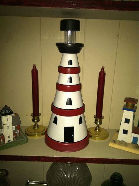 spray paint lighthouse my lighthouse made from flower pots of various sizes