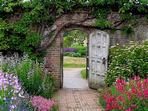 secret garden wall secret garden an wooden door leads into a garden