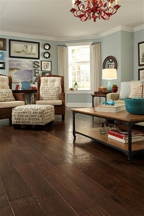 love the ottoman and dark wood floor and wall color house decorators collection