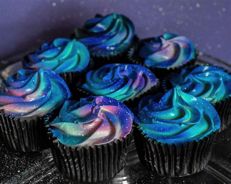 cupcakes and this galaxy themed wedding cake and cupcakes are far out