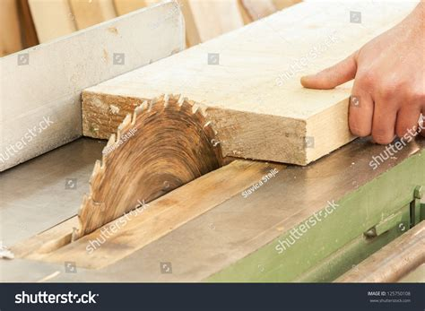 woodwork suppliers carpenter works on woodworking machine tool stock photo