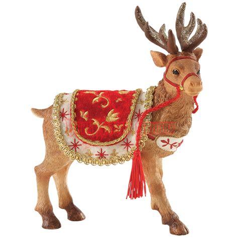 santa and reindeer figurines santa s reindeer figurine by possible dreams