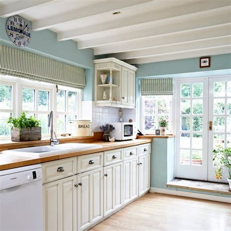 light blue kitchen accessories blue country kitchen with cabinetry