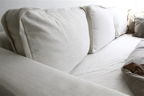 pillow with inside seams stitches and piping subtle slipcover details