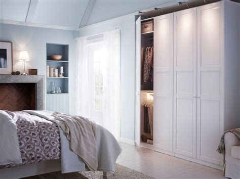 ikea bedroom storage a white bedroom with a large wardrobe combination and a