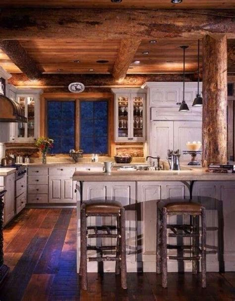 cabin kitchen cabinets log cabin kitchen i the distressed white cabinets