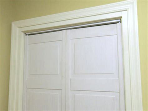 hideaway closet doors how to replace a closet door track hgtv