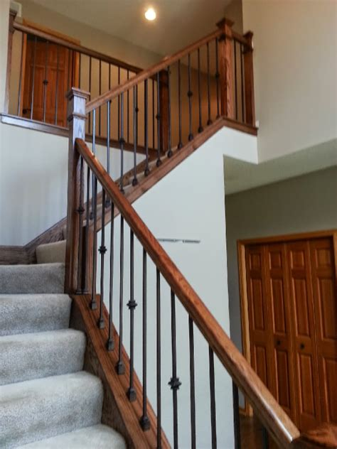 Simple Decorating Ideas For Home clean style oak and iron stairway mystairways