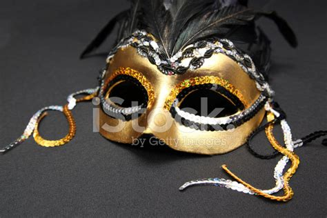 black mardi gras gold and black mardi gras mask with feathers stock photos