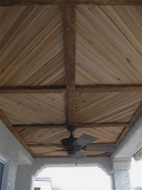 wood ceiling planks covered patio with faux wood beam and plank ceiling