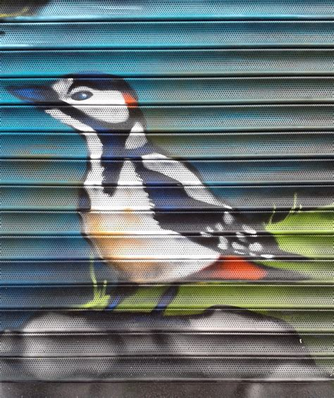 spray painter croydon reeves corner shutters mural graffiti mural