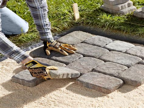 building a patio with pavers laying patio stones building a walkway with pavers