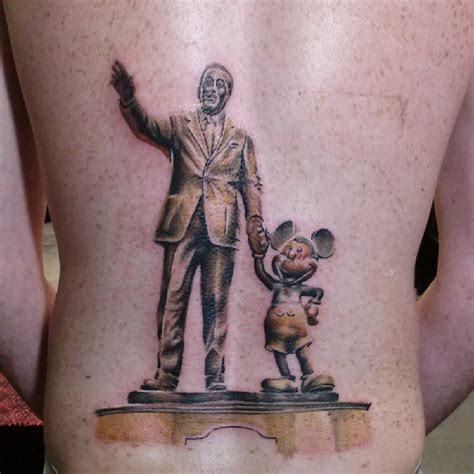 walt and mickey partners statue disney tattoo disney