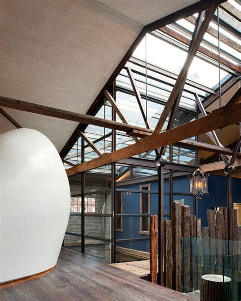 warehouse sydney aj c inserts molded white cocoon into renovated warehouse