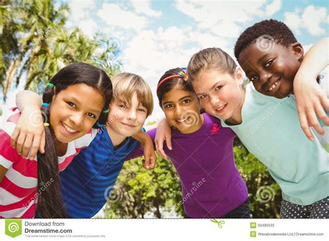with children happy children forming huddle at park stock photo image