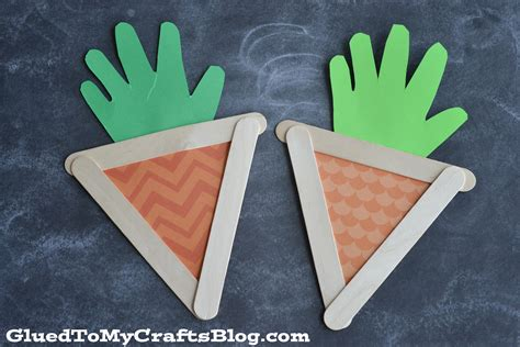 kid crafts with popsicle sticks popsicle stick handprint carrots kid craft glued to my