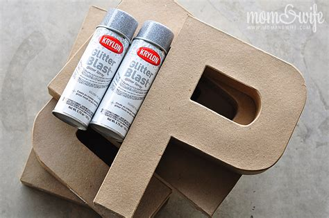 spray paint cardboard glittered cardboard letters