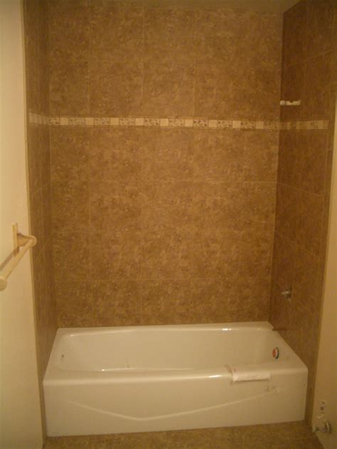 Bathroom And Kitchen Update by Porcelain Tile Shower With Travertine Band