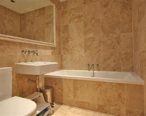 beige tile bathroom ideas photo of modern beige brown orange bathroom with mirror tiled tiles bathroom ideas