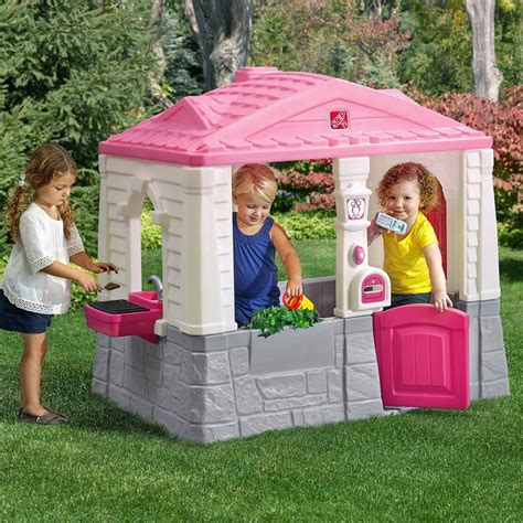 step2 naturally playful neat and tidy cottage magic cottage playhouse step 2 wallpaper