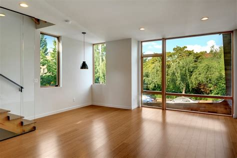 window on ceiling bamboo flooring white walls and floor to ceiling window