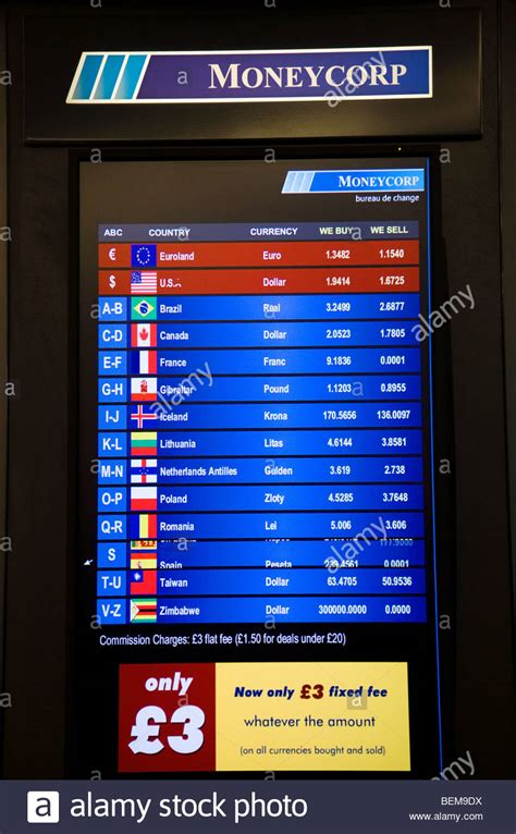 display of exchange rates at a bureau de change office operated by stock photo royalty free