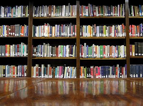 pictures of books in a library libraries warn of censorship privacy cost in s
