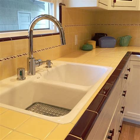 All Metal Kitchen Faucet carolyn s gorgeous 1940s kitchen remodel featuring yellow