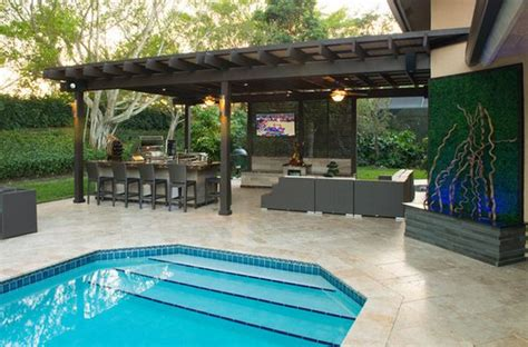 outdoor kitchen designs with pool outdoor kitchen designs featuring pizza ovens fireplaces
