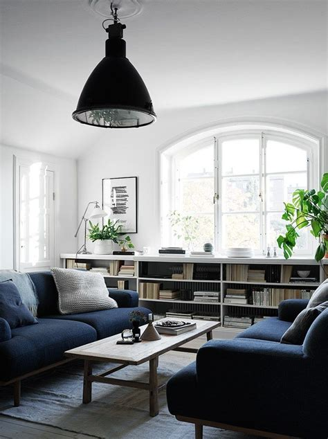 white living room with navy blue pictures photos