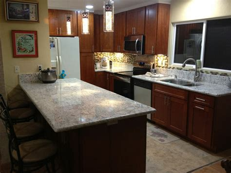 cherry kitchen cabinets with granite countertops light cherry c c cabinets and granite