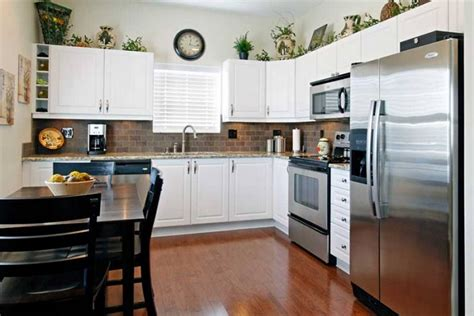 above kitchen cabinets ideas greenery above kitchen cabinets ideas in l shaped kitchen cabinets decolover net