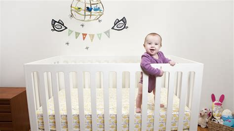 baby sleeps on side in crib recall franklin ben 4 in 1 convertible cribs
