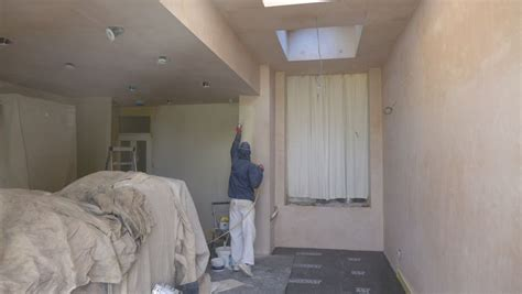 spray painting on walls fitting a new kitchen style within