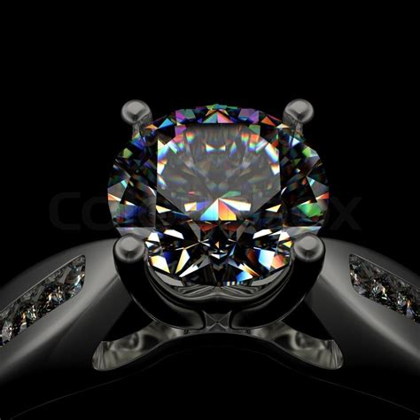 Luxury Log Home Plans ring with diamond on black background stock photo