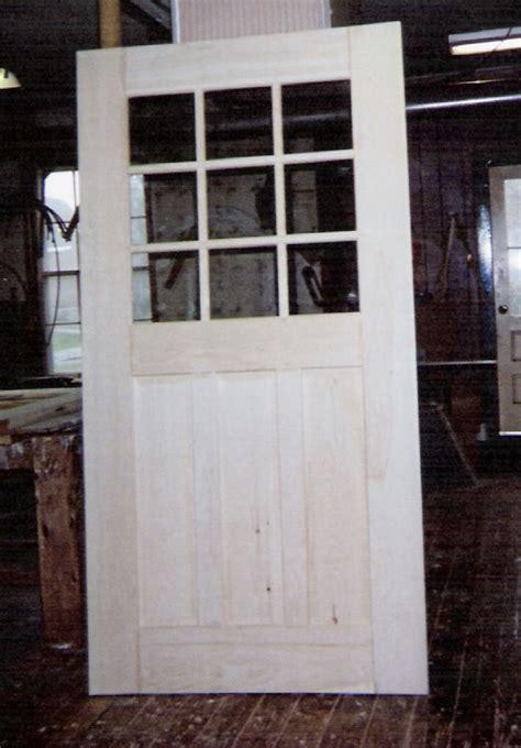 custom built wood exterior doors entryway arch top