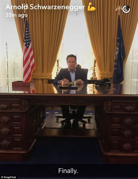the oval office desk arnold schwarzenegger sits at replica of richard nixon s