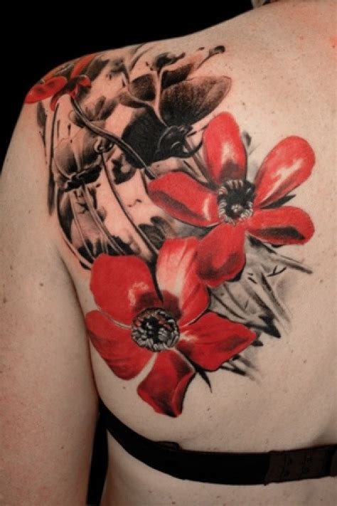 red and black flowers tattoo on shoulder blade