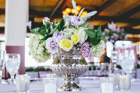 purple and yellow wedding centerpieces centerpieces with soft purple and yellow roses