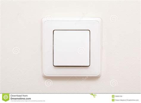 modern light switch on white wall