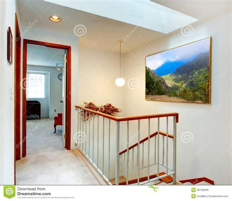 Simple 2 Bedroom House Plans bright hallway view of staircase and bedroom royalty free