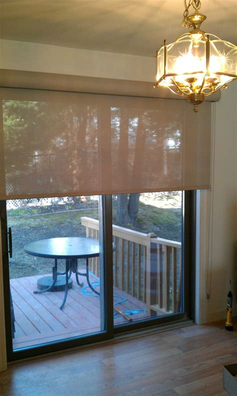 shades for sliding patio doors solar roller shade on a sliding door sliders and patio