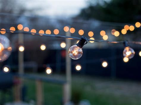 how to hang outdoor patio string lights how to hang outdoor string lights from diy posts hgtv