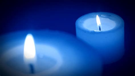 blue candles candle burning and flickering and candle extinction