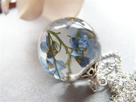 resin flowers for jewelry forget me not necklace resin orb blue pressed flower